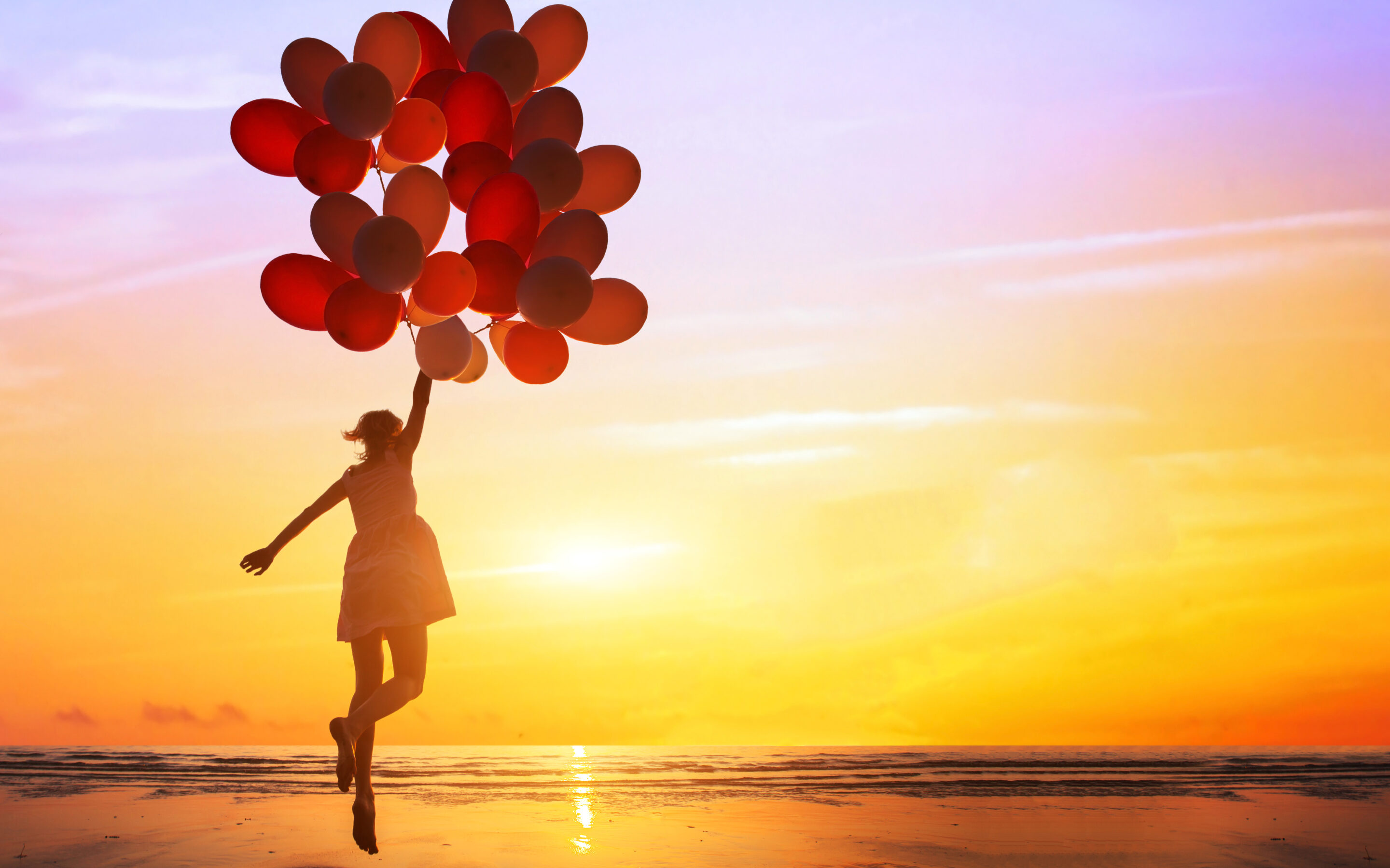Happiness Concept, Happy woman jumping with balloons
