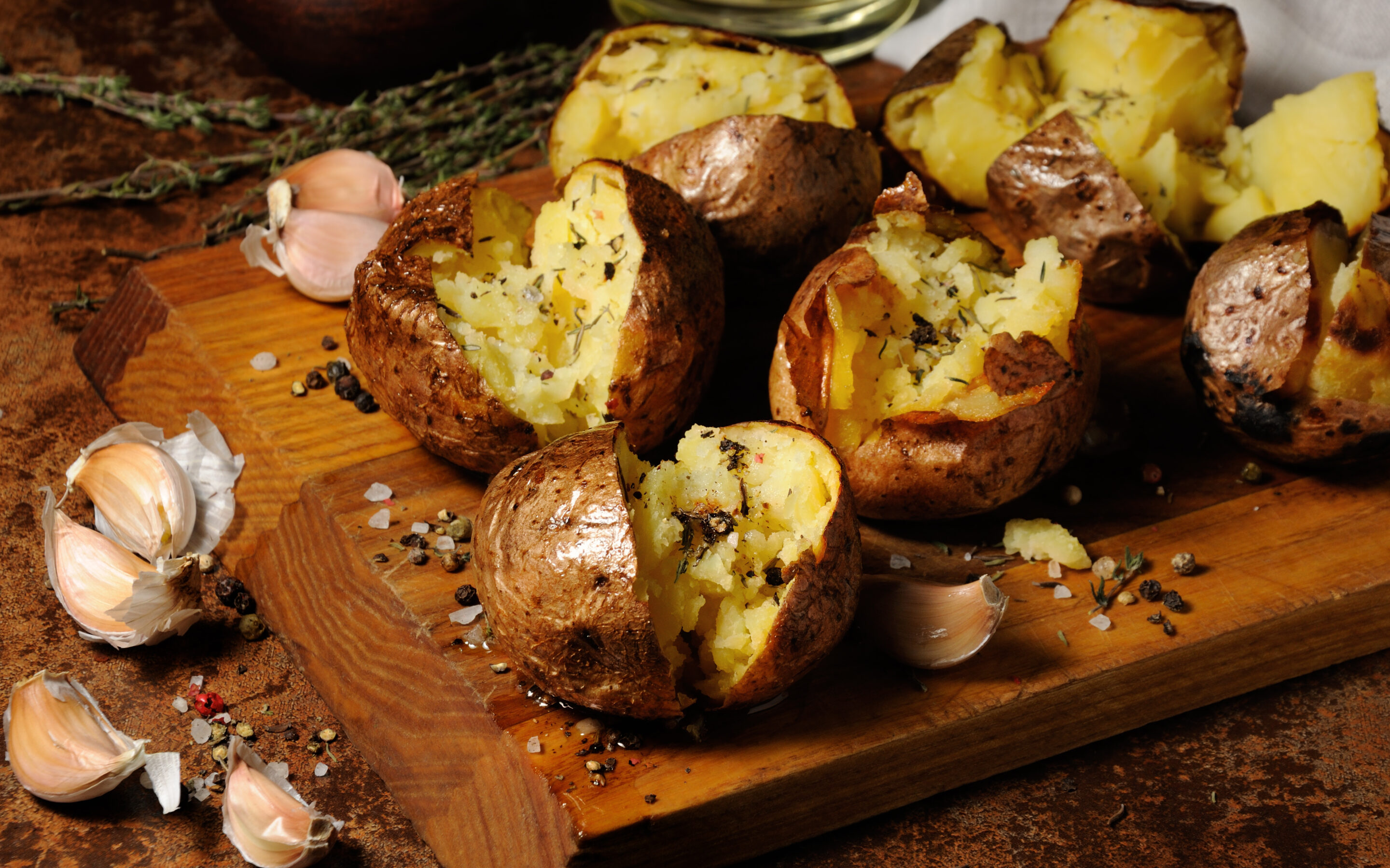 Best Baked Potatoes on a wooden board with spices