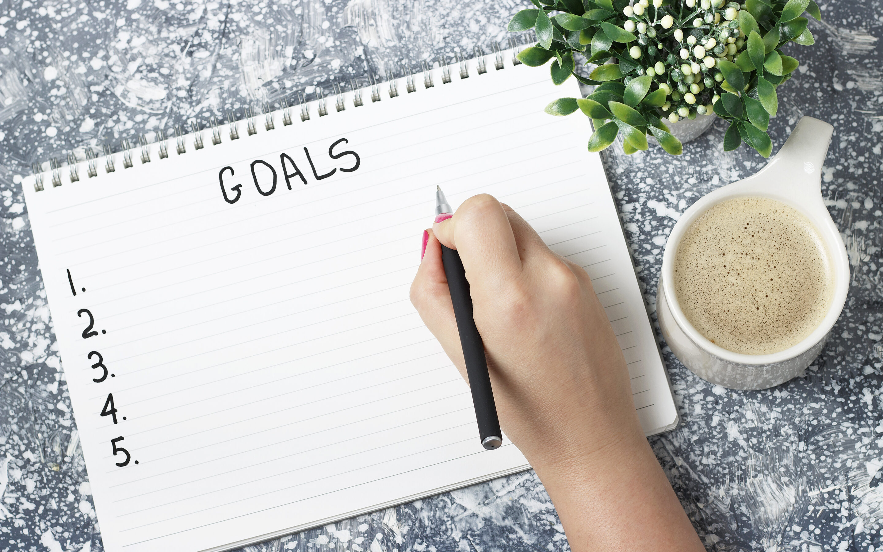 Woman writing out her goals