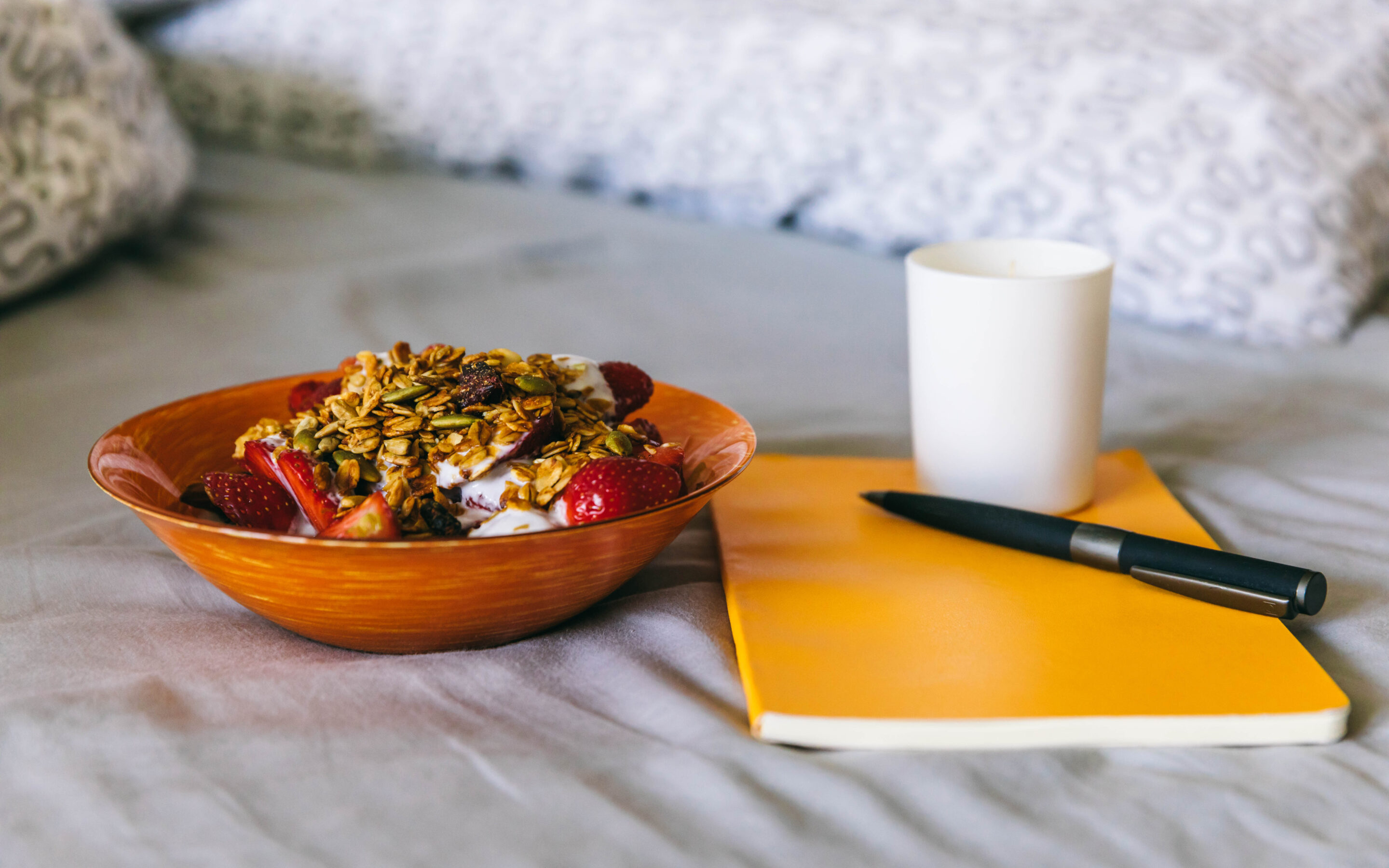 bowl of granola beside journal depicting a detox of life