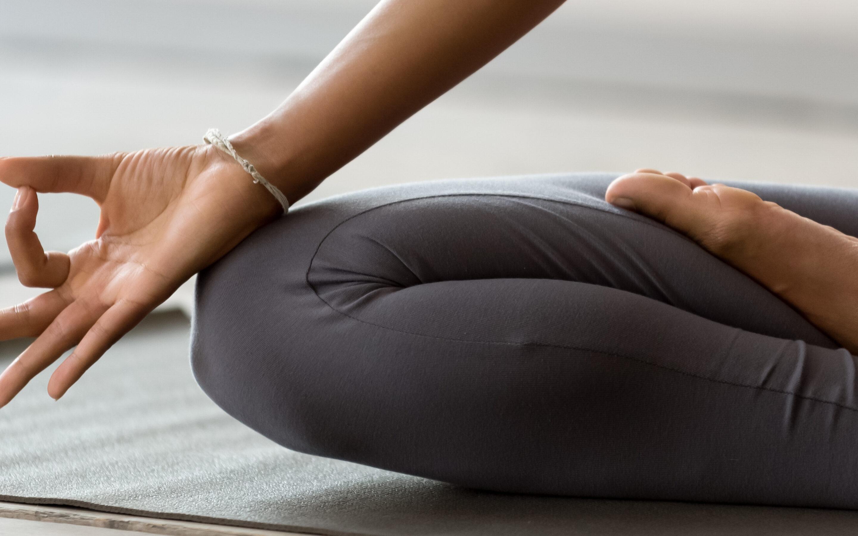 Woman on yoga mat meditating